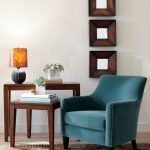 comfy blue chairs for small spaces with wooden tables beautified with table lamp and plant pot plus cool wall with frames and pretty brown rug