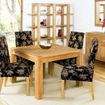 comfy chairs for small spaces in dining room with floral motif and square wooden table plus display shelves for porcelen arts and sideboard plus mirror