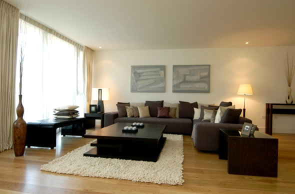 Contemporary Living Room With Darker Grey Tone Color Sectional Sofa And  Black Table A White Fury