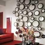 cool round mirror sheffield home mirrors in living room with red sofa with cushions and rug plus wooden coffee table with flower vase