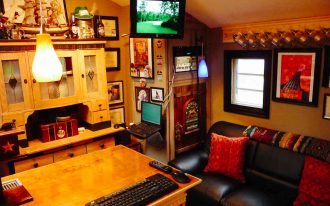 cool transformation sheds turned into homes with wooden desk and cabinets plus pendant lamp plus black leather sofa and red cushion plus tv