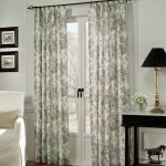country floral patterned curtain design for french door with black rod aside black side table with black table lamp and white sofa