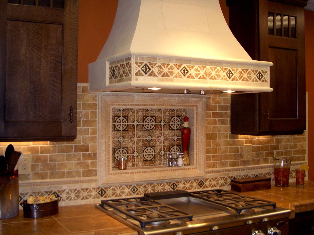 Get your kitchen bathed with awe with the touch of gorgeous spanish cream mosaic tile backsplash for kitche beneath giant smokestack with center disctinctive pattern dailygadgetfo Gallery
