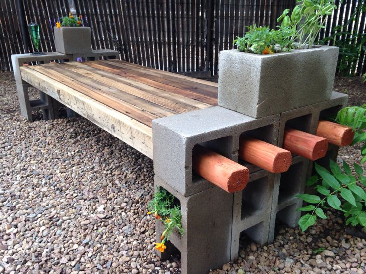 Creative Wooden Bench Design With Concrete Planter Boxes Desingn Aside Black Wooden Fence With Red Accent