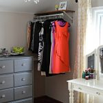 diy dressing room with shelf with hanging rod combinet with grey drawer cabinets plus vintage make up desk with mirror and stool plus wooden floor and curtain