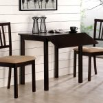 drop leaf dining table for small spaces for two people in black wooden finishing table plus two comfy chairs and wooden floor plus decorative wall with picture