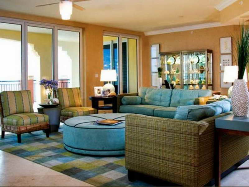 florida home interiors. elegant and classic florida room design with blue sofa armchairs  round coffee table Move Your Interior Florida Style to Steal Warm