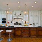 Elegant Kitchen Remodeling Northern Va With Brown And White Wooden Cabinets Plus Island With Stylish Chairs And Backsplash And Classy Chandeliers