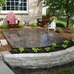 elevated mini garden plus patio with Fond Du Lac stones frame construction a pair of wood chairs in red  a small wood chair in white color shiny patio's floor