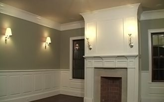 evening hue wall design with white accent and wall lantern and flat crown molding idea with fireplace