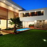 exterior home design in contemporary style a small outdoor pool a patio beautiful garden clear lines building structure modern lighting technique