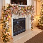 fancy christmas decorations for mantels with colourful christmas baubles and ribbon with green garland and string lighting