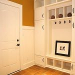 Fantastic Cool Practical Mudroom Design With White Coloring Concept And Has A Photograph Under The Coat Hooks