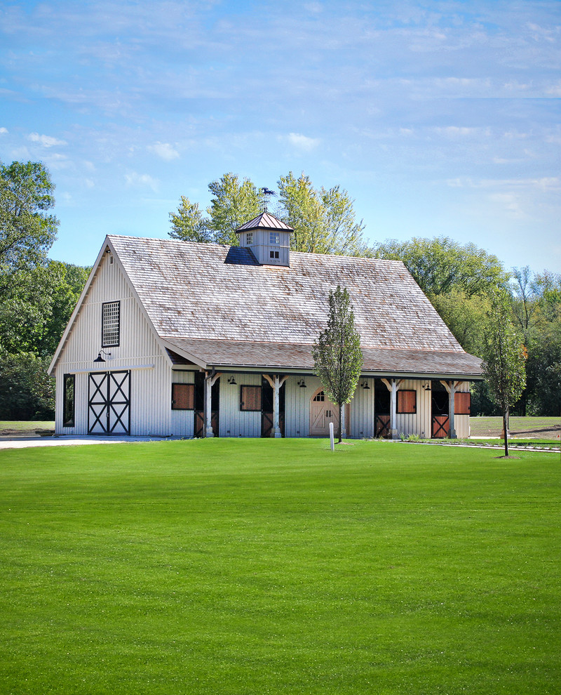 Pole barn house pictures that show classic construction for Farmhouse plans with pictures