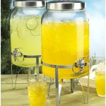 fresh double glass beverage dispenser with metal spigot with steel stand and glasses and steel lids