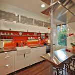 fresh kitchen remodeling northern va with orange wall and white kitchen cabinets plus steel countertops and small kitchen island with bar stools