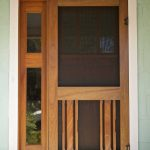 front door with black screen panel a sidelight feature with wood frame