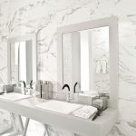 glamour master bathroom with porcelain tile that looks like marble flooring and wall combined with stylish bathroom vanity units and double mirrors plus sink