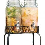 glass beverage dispenser with metal spigot with pretty shape plus dispenser stand from metals