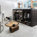 glass windows in living room with under window bookcase together with shoes and closet organizer plus black gray chairs and standing lamp and glass top table