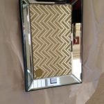 Gorgeous And Luxurious Stainless Steel Framed Rectangle Wall Mirror Idea With Chevron Pattern