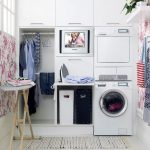 gorgeous coloful laundry room design with white washer and dryer cabinet design with ironing board with glass window