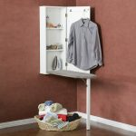 Gorgeous Corner Fold Up Ironing Board Storage Design Inside Storage Cabinet With Rattan Basket And Cloth Hanger Beneath Marroon Wall