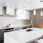 gorgeous kitchen ceiling decoration idea with beautiful white pendants and stunning modern cabinetry design with cashemere white granite and flower