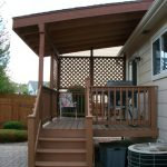 gorgeous natural porch design with wooden roof with vertical wooden fence idea with staircase and wooden deck floor with pebbles aside drum