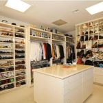 gorgeous walk in closet design with handbag storage idea in freestanding model aside white island with small and medium slots size
