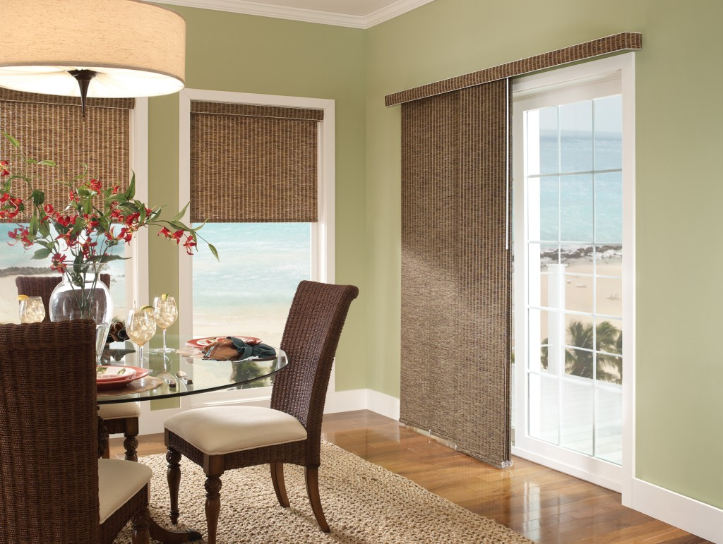 gorgeous white framed glass french door design with elegant brown curtain idea and rolled rattan drape design behind dining table with round glass table with seating