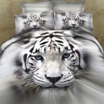 gorgeous wild tiger pattern on the fun bed sheet on th quilt and pillows in sweet gray color
