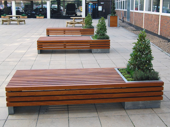 Gorgeous Wooden Furnished Bench Design With Corner Concrete Planter Boxes  Design With Small Pine Tree Upon