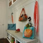 Great Amazing Practical Mudroom Design With White Concept And Has Some Bags Hanged On The Hooks And Shoes Case