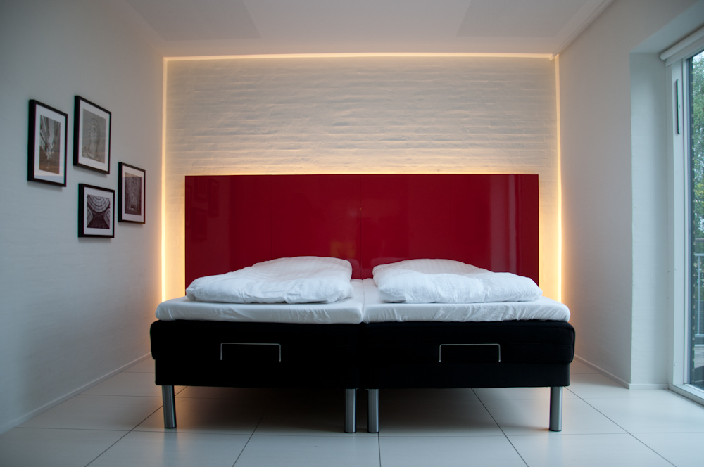 headboards at ikea in red glossy surface combined with white bedding set and pictures and wall