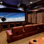home theater design with large screen a proyector and brown leather sofas