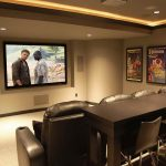 home theater idea for small room with black leather sofas and  black bar table plus black chairs a big flat screen