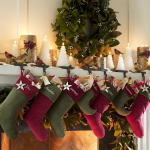 impressive christmas decorations for mantels with stocking and candles in tree shapes plus fresh wreath on wall and birds ornaments
