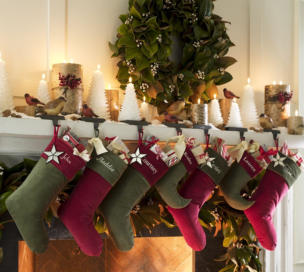 celebrate the joyful christmas moments in your home with welcoming impressive christmas decorations for mantels with stocking and candles in tree shapes plus fresh wreath on
