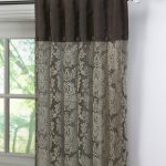 impressive inverted pleat drapes curtain in brown installed on glass windows