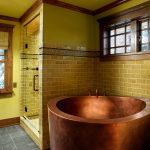 japanese soaking tub small in classic bathroom ideas with walk in shower plus brick patterned wall plus window and gray tile flooring