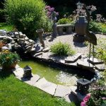 landscape idea with artificial pond with natural stones wall some garden features some built in lghting fixtures for garden by Better Homes and Gardens