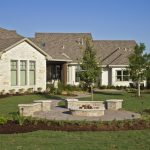 large and luxurious Texas Hill Country residential home design with patio white bricks permanent seats round in ground fire pit table