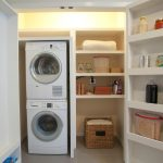 large white wooden storage design with racks with rattan basket with washer and dryer and modern lighting