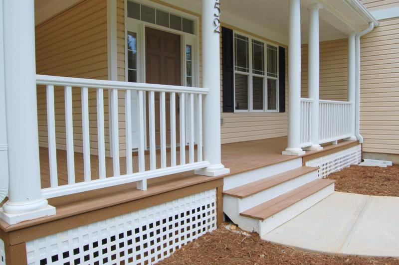 light tone color wood planks floors for porch white vertical wood rails for porch - Home Porch Design