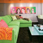 living room in retro style with bright green sofa plus colorful pillows light blue glass surface tables a black chair with green patterns men paintings as wall decoration black rug