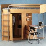 loft bed deks combo with clothing closet a black chair stair feature and  built in bookshelves