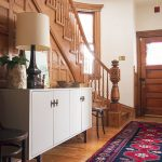 lovely entry way rugs in victorian style combined with white wooden sideboard and table lamps under the stairs together with wooden flooring and chairs