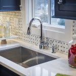 marvelous best kitchen sink material with white marble countertops plus modern faucet and awesome backsplash and window for kitchen