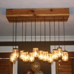 mason jar lighting fixtures and chandeliers with cedar bases and wooden panel on the ceiling for home lighting ideas
